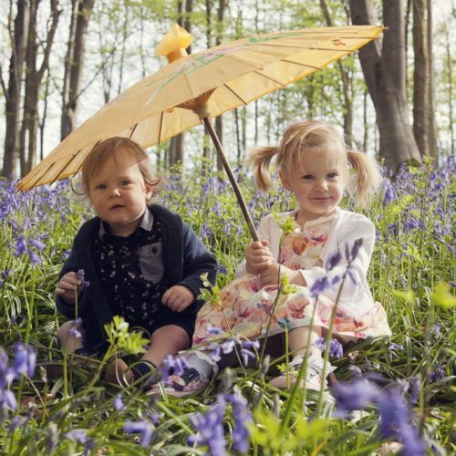Boy-and-girl-in-bluebells-with-paracol