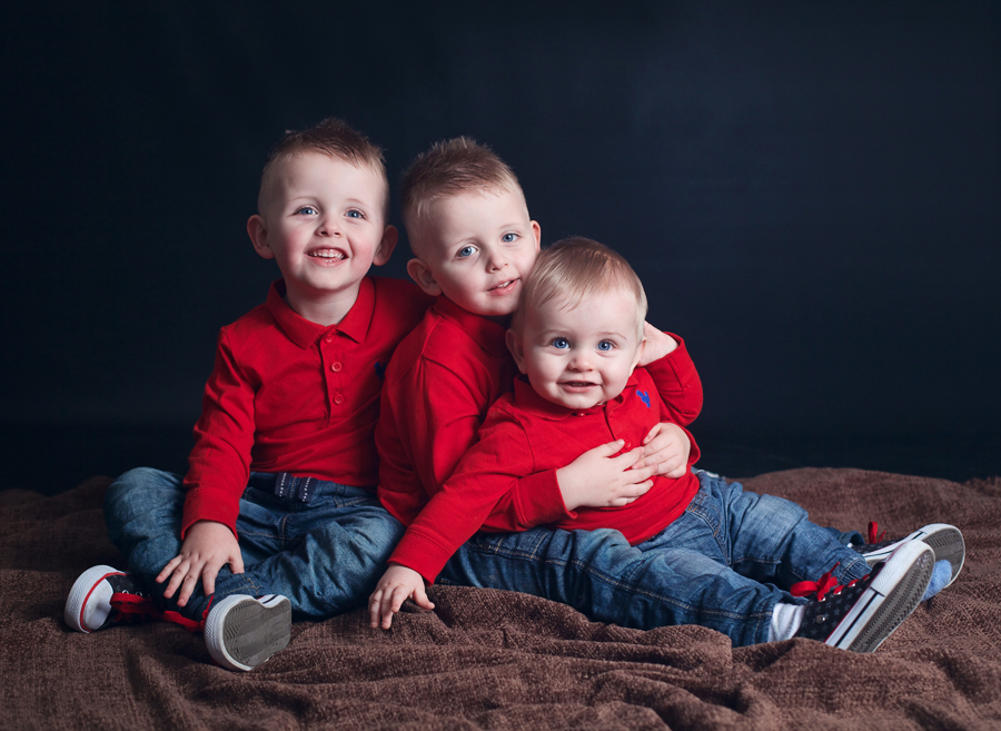 three boys in a family portrait at PhotoBaby Lancashire