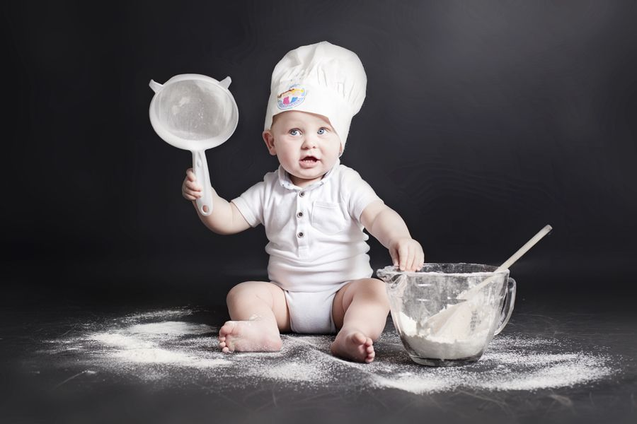 Photo of a first birthday cake smash baking session at PhotoBaby in Lancaster.