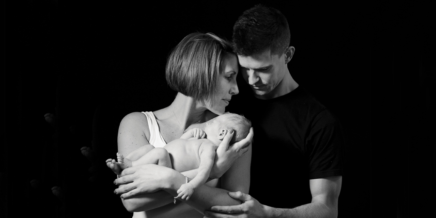 black and white newborn portrait with family.