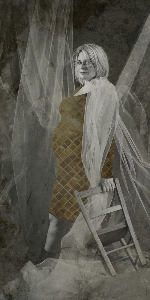 Black and white portrait of pregnant woman, fabric fGold glitter overlaid on her bump. Alternative maternity portrait, Lancaster PhotoBaby studio.
