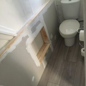 new floor boards and boarded in pipes in toilet.
